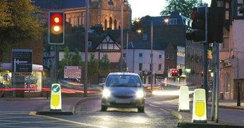 car-waiting-at-traffic-lights-at-dusk.jpg