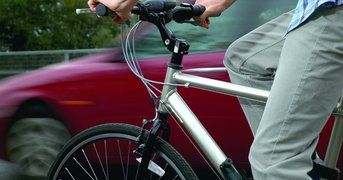 cyclist-and-passing-car.jpg