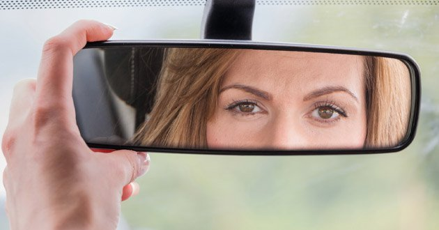 lady's-reflection-in-rear-view-mirror.jpg