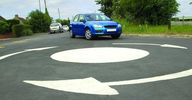 Car-waiting-at-mini-roundabout.jpg